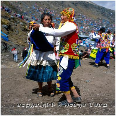 Dancing couple at Qoyllur Rit'i pilgrimage, photo copyright Jorge Vera