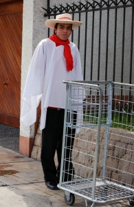 Wong employee dressed as Peruvian cowboy for Fiestas Patrias, by Barbara Drake